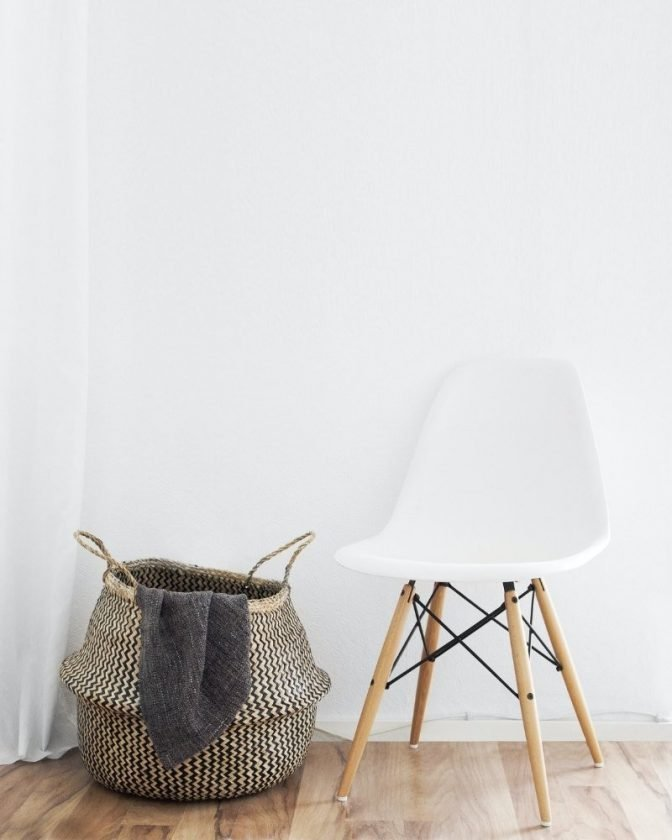Sustainable chair and basket with a white background